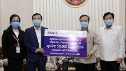 Doanh nghiệp Việt tài trợ 370.000 USD giúp Lào chống COVID-19