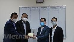 Doanh nghiệp Việt Nam tài trợ hơn 10.000 USD cùng Campuchia phòng chống dịch COVID-19