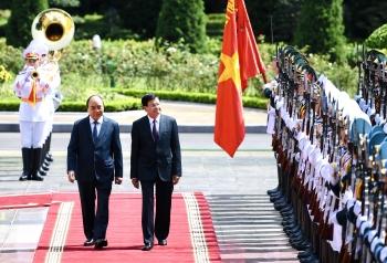 Chủ tịch nước Nguyễn Xuân Phúc chủ trì Lễ đón Tổng Bí thư, Chủ tịch nước Lào