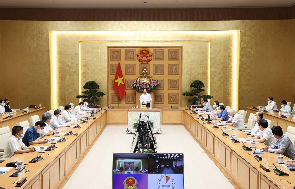 Thủ tướng Phạm Minh Chính gặp gỡ bác sỹ, nhà khoa học, nhà giáo trong lĩnh vực y tế  (Ảnh: Dương Giang/TTXVN)