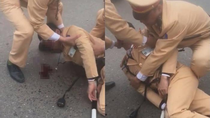 Hà Nội: Danh tính đôi nam nữ vượt đèn đỏ, tông trung úy CSGT bất tỉnh