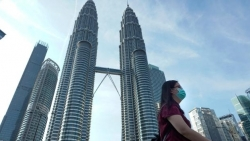 chinh phu malaysia xin loi vi khuyen phu nu hay trang diem va bot can nhan mua covid