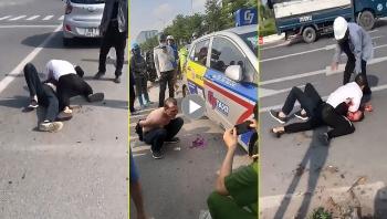 Tài xế taxi vật lộn với tên cướp đang bị truy nã