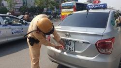 Xử lý tài xế taxi che biển số né phạt nguội