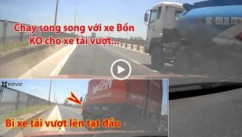 Đi song song với xe bồn trên cầu, ôtô con bị xe tải tạt đầu vì không chịu nhường đường