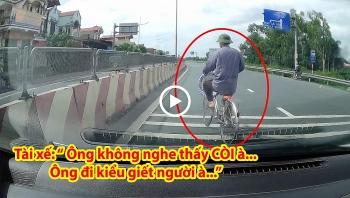 Cụ ông đi xe sang đường không quan sát khiến tài xế ô tô phải dừng lại nhường đường