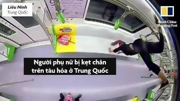 """Video: Thử động tác """"trồng cây chuối"""" trên tàu hỏa, người phụ nữ bất ngờ bị mắc kẹt phải kêu cứu"""