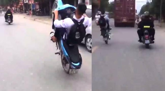 video nam sinh boc dau thach thuc 2 canh sat co dong