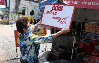 Hà Nội cho mở lại hàng cắt tóc, quán ăn được bán mang về